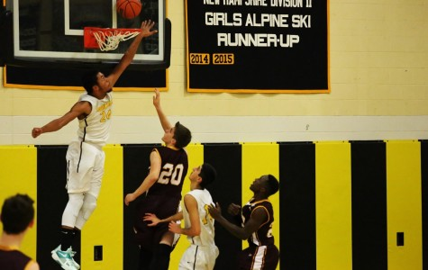 Jerrel Webster, number 24, flies in the air to deny a basket shot by Lebannon number 20.