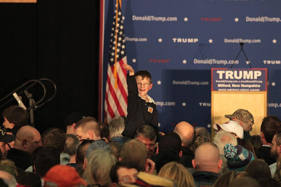 Little+boys+waves+to+all+the+cameras+while+waiting+for+Trump+to+take+the+stage.+