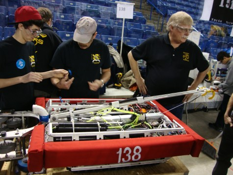 Team members work on their robot during the competition.
