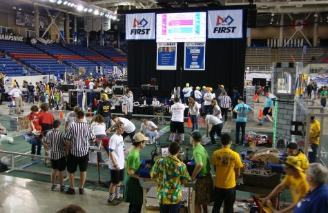 Voluteers and team members set up for a match