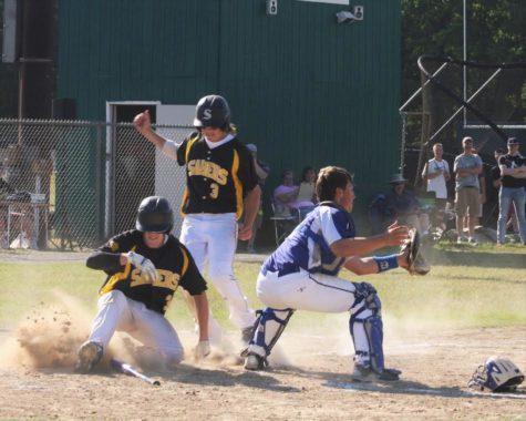Thomas Bennett and Jacob Grassett hitting home plate