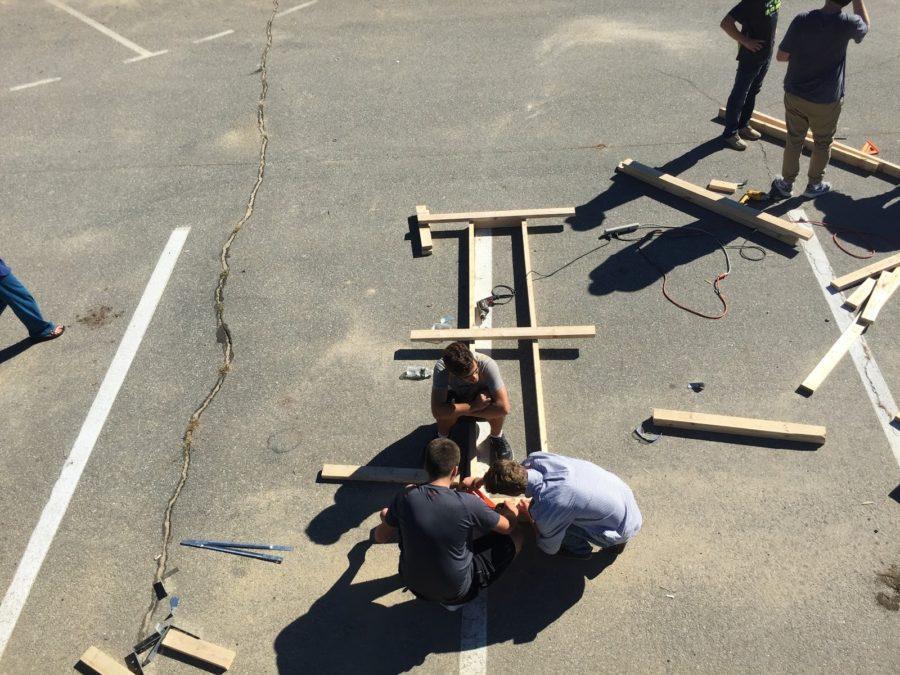 Students building a King Arthur style trebuchet
