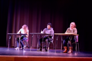 """Students"" in the first act getting in character."