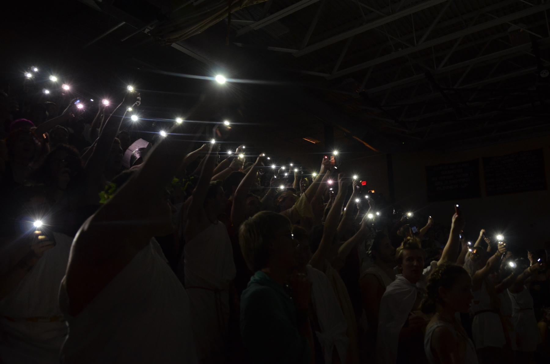 Seniors+turn+off+the+lights+and+turn+on+their+flashlights+during+their+dance.