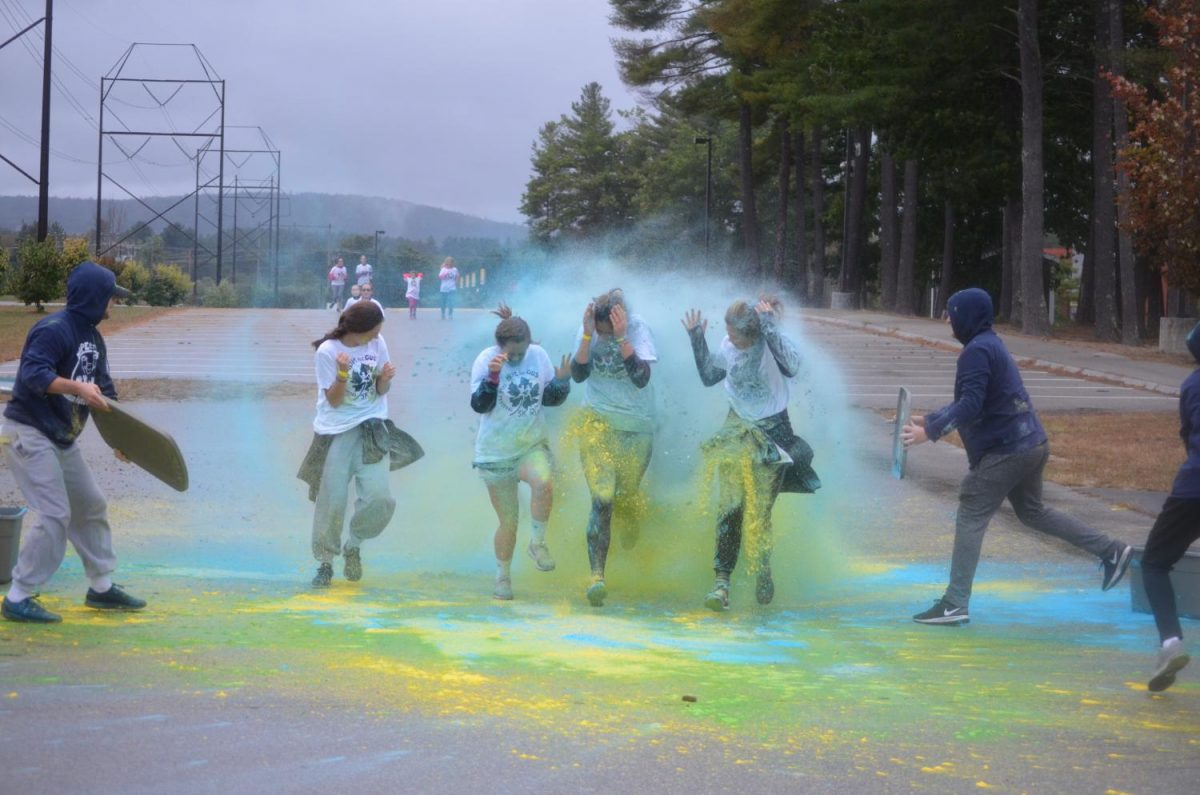 The final paint station doused the runners in powered paint before the finish line.