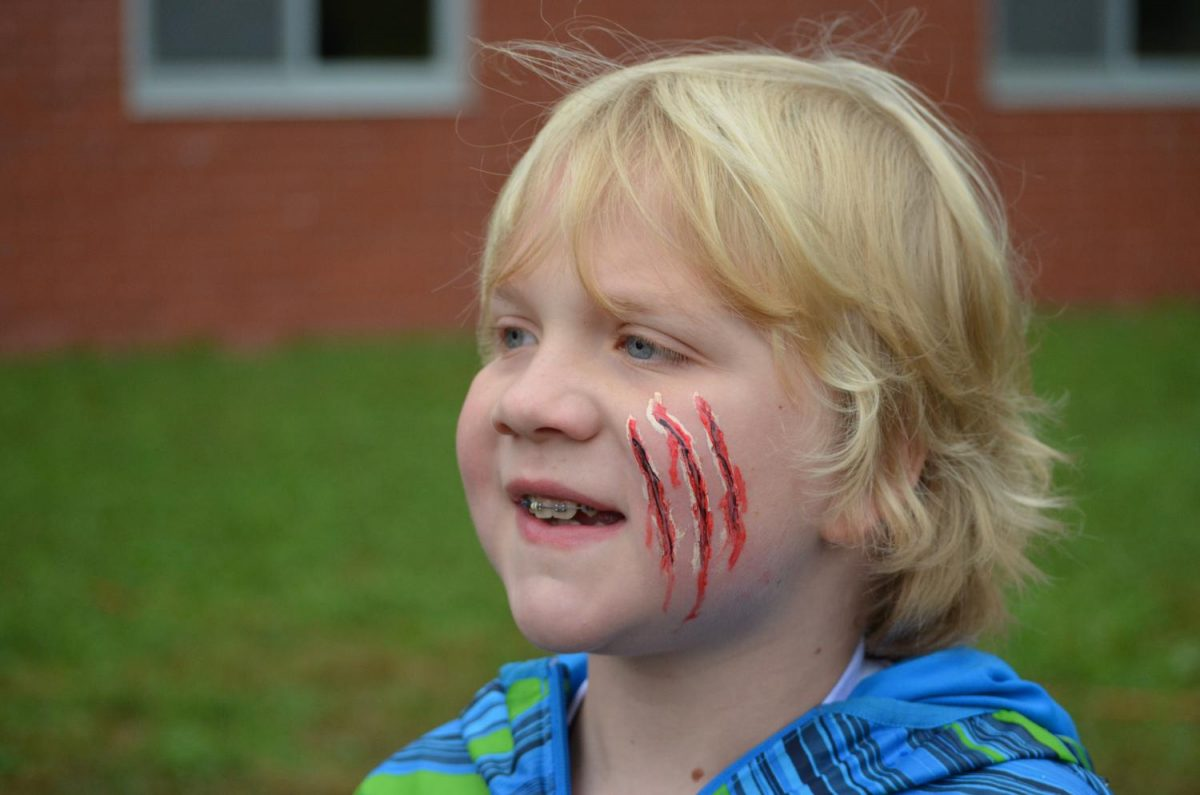 Gus shows off his Saber claw mark face paint.