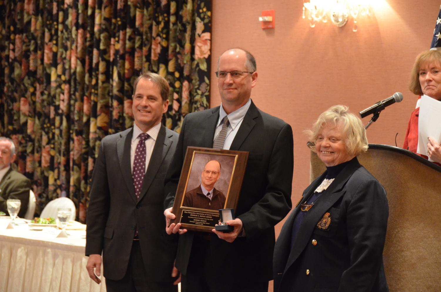 N.H.+Education+Commissioner+Frank+Edelblut+%28left%29+and+NHASP+Executive+Director+Peggy+McAllister+%28right%29+gave+Rob+Scully+his+award.