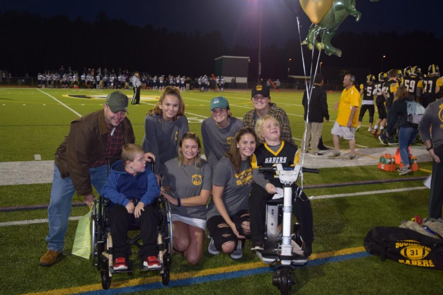 The Souhegan Ethics Forum presented Gus and his friend with gifts before the game.