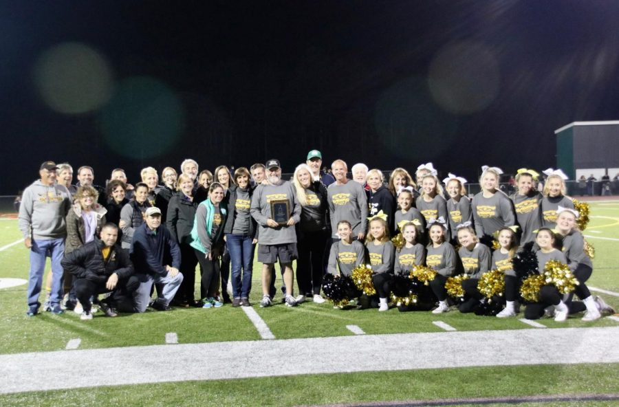 Souhegan faculty and cheer squad joined Dick Miller when he received his plaque.