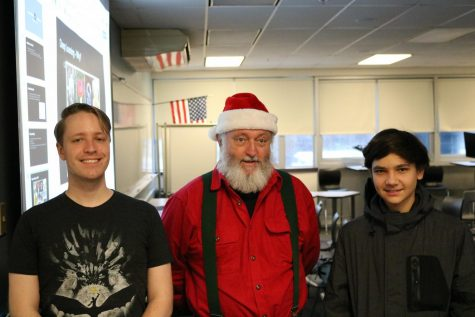 Christian Barret (left) poses with Ranta Claus and Avery Bertrand (staff writer).